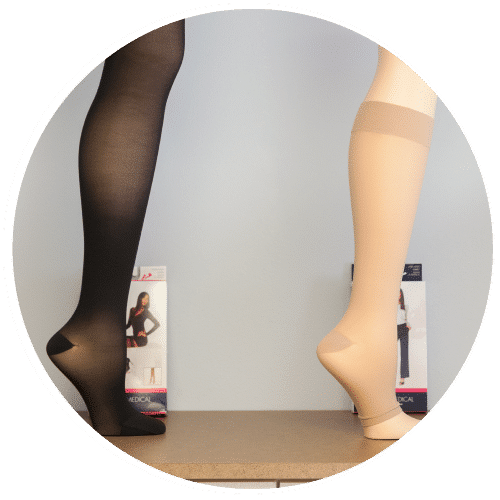 A black compression stocking hose next to a flesh tone colored one