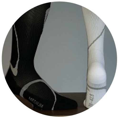 A white and black compression stocking for varicose veins